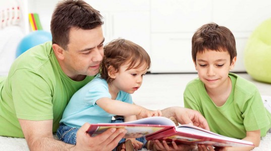 Father reading with his family.